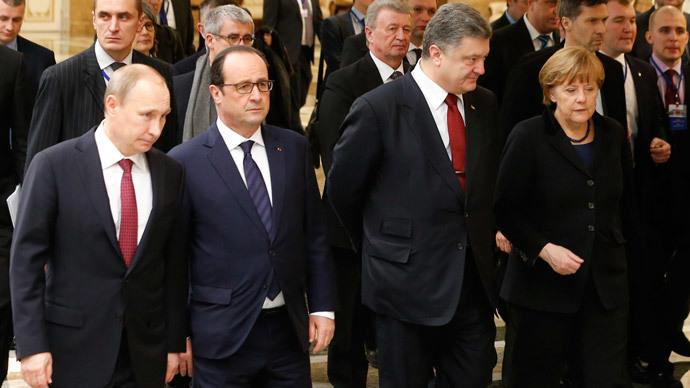 Russia's President Vladimir Putin (L, front), Ukraine's President Petro Poroshenko (2nd R, front), Germany's Chancellor Angela Merkel (R, front) and France's President Francois Hollande (2nd L, front) walk during peace talks in Minsk, February 11, 2015.(Reuters / Vasily Fedosenko)