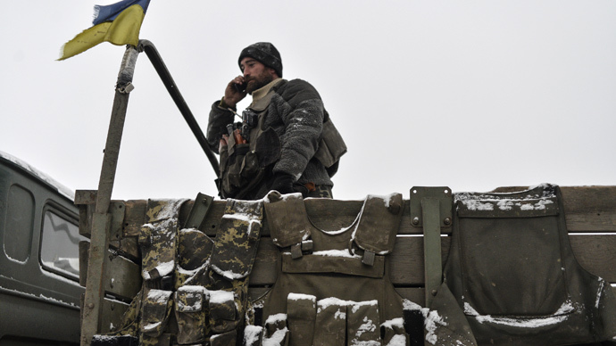 A Ukrainian serviseman talks on his mobile phone outside Debaltsevo, eastern Ukraine February 10, 2015. (Reuters / Alexei Chernyshev)