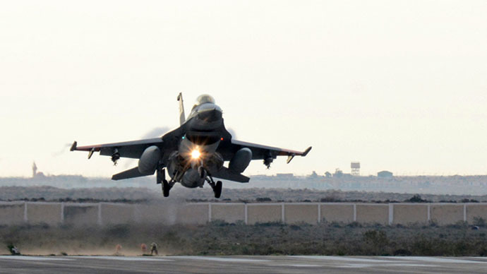 A handout picture released by the Egyptian Ministry of Defence on February 16, 2015 shows an Egyptian air force fighter jet landing at an undisclosed location in Egypt following air strikes in Libya. (AFP Photo)