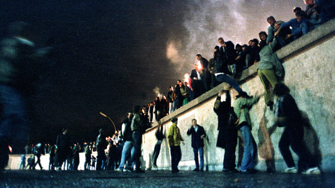East German citizens climb the Berlin wall at the Brandeburg gate after the opening of the East German border was announced in this November 10, 1989 file photo. (Reuters)