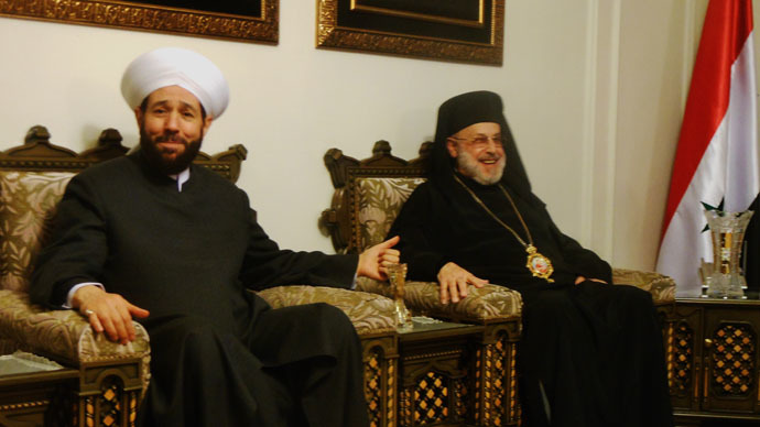 Syria's Grand Mufti Ahmad Badr Al-Din Hassoun and Syrian Greek Orthodox Bishop Luca al-Khoury (Photo by Eva Bartlett)