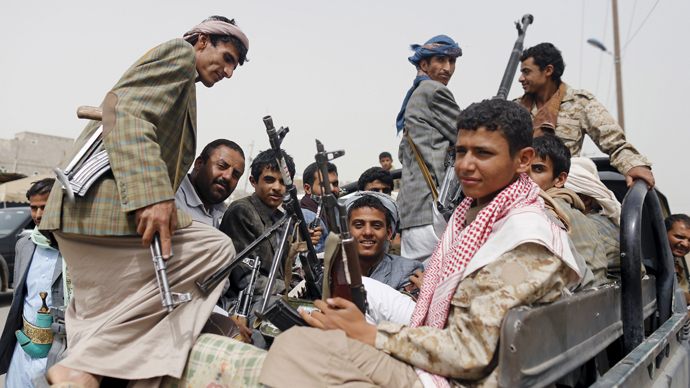 Houthi fighters ride a patrol truck outside Sanaa Airport March 28, 2015. (Reuters / Khaled Abdullah)