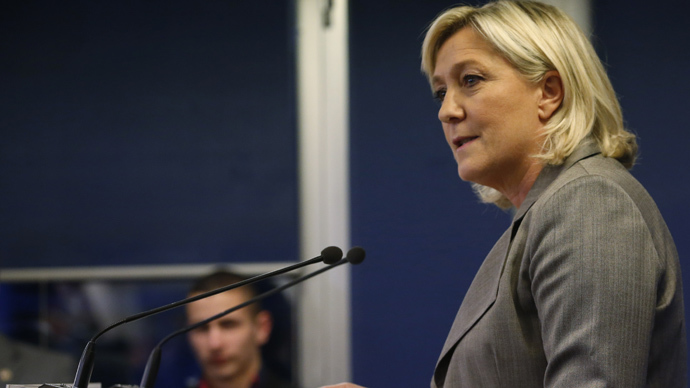 France's far-right National Front political party leader Marine Le Pen leaves a news conference after the close of polls in France's second round Departmental elections of local councillors at their party's headquarters in Nanterre, near Paris, March 29, 2015. (Reuters/Charles Platiau)