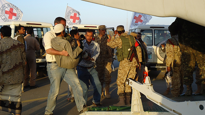 Red Cross medics carry a wounded man to a plane during an evacuation of injured people from Dammaj, in Yemen's northwestern province of Saana (Reuters / Stringer)