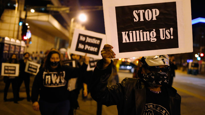 Protesters march through the streets as they demonstrate against what they say is police brutality after the Ferguson shooting of Michael Brown in St. Louis, Missouri (Reuters / Jim Young)