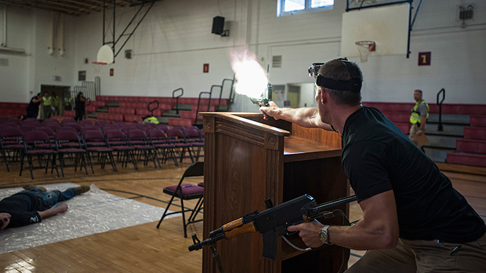 Rick Scott of security contractor Camber Corp impersonates a hostile shooter during a training exercise at Quantico Middle High School in Quantico, Virginia (Reuters / James Lawler Duggan)