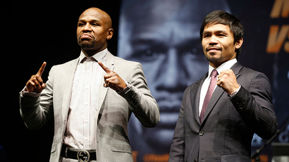 "Eleven-time, five-division world boxing champion Floyd ""Money"" Mayweather (L) and eight-division world champion Manny ""Pac-Man"" Pacquiao pose at a news conference ahead of their upcoming bout, in Los Angeles, California (Reuters / Lucy Nicholson)"