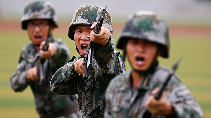People's Liberation Army (PLA) soldiers shout as they hold guns and practise in a drill in Beijing (Reuters / Petar Kujundzic)