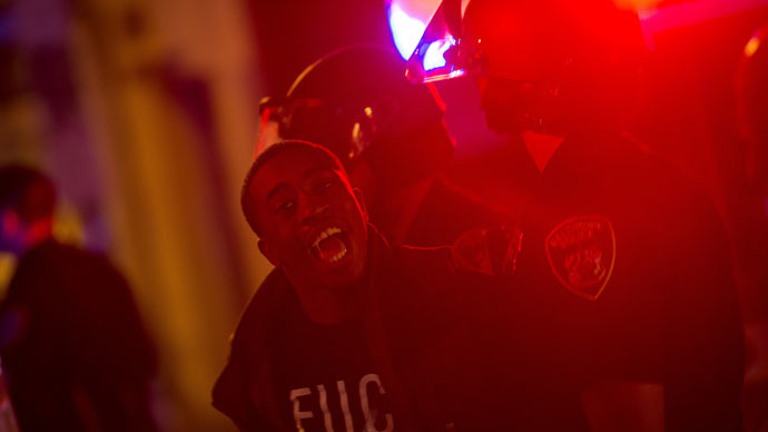 A demonstrator is taken into custody after a citywide curfew in Baltimore, Maryland May 2, 2015. (Reuters/Eric Thayer)
