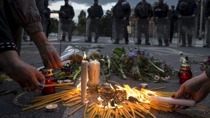 People light candles to commemorate policemen who were killed in a gun battle, during a memorial in Skopje, Macedonia, May 11, 2015. (Reuters/Marko Djurica)