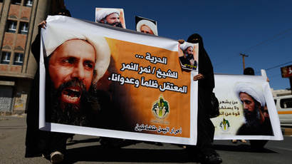 Shi'ite protesters carry posters of Sheikh Nimr al-Nimr during a demonstration outside the Saudi embassy in Sanaa (Reuters / Khaled Abdullah)