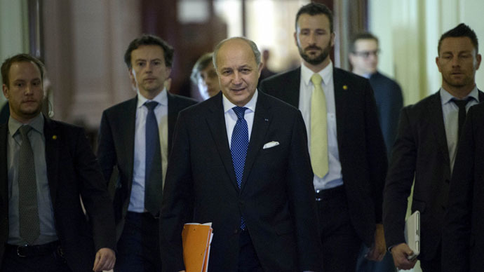 French Foreign Minister Laurent Fabius (C) walks with others during a break in a meeting with world representatives seeking to pin down a nuclear deal with Iran at the Beau Rivage Palace Hotel in Lausanne March 31, 2015. (Reuters/Brendan Smialowski)