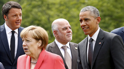 U.S. President Barack Obama stands beside Iraqi Prime Minister Haider al-Abadi (2nd L) during a leaders and outreach guests group photo at the Group of Seven (G7) Summit in the Bavarian town of Kruen, Germany June 8, 2015. (Reuters/Kevin Lamarque)