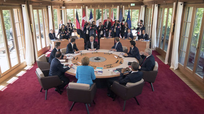 French President Francois Hollande, British Prime Minister David Cameron, Italy's Prime Minister Matteo Renzi, Germany's Chancellor Angela Merkel, European Union Commission President Jean-Claude Juncker, President of the European Council Donald Tusk, Japanese Prime Minister Shinzo Abe, U.S. President Barack Obama and Canada's Prime Minister Stephen Harper attend the first working session of a G7 summit at the hotel castle Elmau in Kruen, Germany, June 7, 2015. (Reuters/Peter Kneffel)