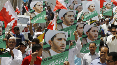 Protesters holding photos of Bahrain's main opposition leader and Secretary-General of Al-Wefaq Islamic Society Ali Salman as they march during an anti-government protest after Friday prayers in the village of Diraz, west of Manama, June 12, 2015. (Reuters/Hamad I Mohammed)