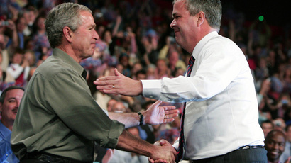 George W. Bush (L) and his brother Jeb Bush (Reuters / Jason Reed)