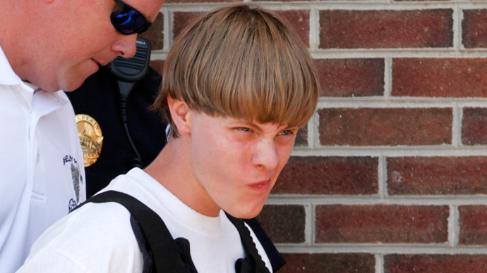 Police lead suspected shooter Dylann Roof, 21, into the courthouse in Shelby, North Carolina, June 18, 2015. (Reuters / Jason Miczek)