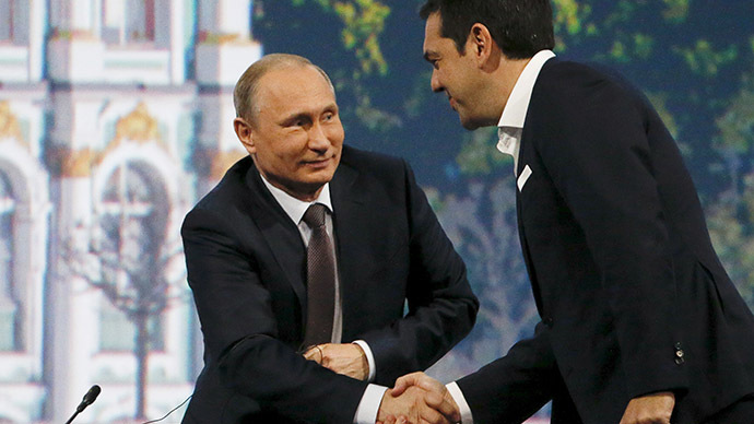 Russian President Vladimir Putin (L) shakes hands with Greek Prime Minister Alexis Tsipras during a session of the St. Petersburg International Economic Forum 2015 (SPIEF 2015) in St. Petersburg, Russia, June 19, 2015. (Reuters / Grigory Dukor)