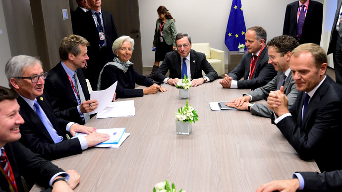 European Commission President Jean Claude Juncker (2nd L), International Monetary Fund Managing Director Christine Lagarde (4th L), European Central Bank President Mario Draghi (C), Eurogroup President Jeroen Dijsselbloem (2nd R) and European Council President Donald Tusk (R) attend a meeting with unidentified officials at a Eurozone emergency summit on Greece in Brussels, Belgium, June 22, 2015. (Reuters / Emmanuel Dunand)