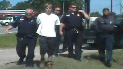 South Carolina shooting suspect Dylann Roof (C) is escorted by police after being detained in Shelby, North Carolina June 18 (Reuters / Shelby Police Department / Handout)