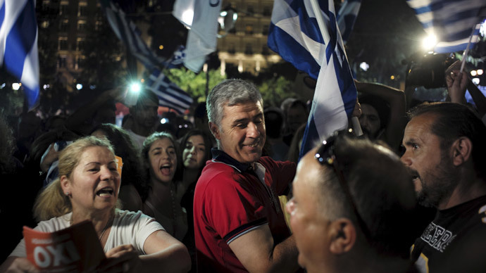 """No"" supporters shout slogans and wave Greek national flags during celebrations in Athens, Greece July 5, 2015.(Reuters / Dimitris Michalakis)"