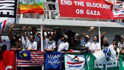 "ARCHIVE PHOTO: Activists gesture from the ""Stefano Chiarini"" ship, which is part of the ""Freedom Flotilla II"", during a demonstration against the Greek authorities' ban on Gaza-bound ships on the Greek island of Corfu July 2, 2011. (Reuters / Marko Djurica)"