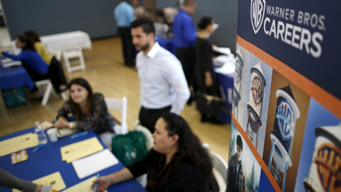 Job seekers browse tables at a veterans' job fair in Burbank, Los Angeles, California (Reuters / Lucy Nicholson)