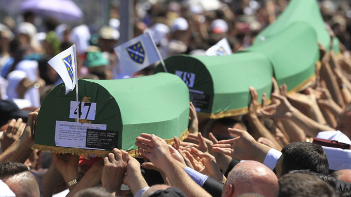 People carry coffins to graves at the Memorial Center Potocari, near Srebrenica, Bosnia and Herzegovina July 11, 2015. (Reuters/Antonio Bronic)