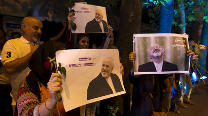 Iranians hold pictures of Iranian Foreign Minister Mohammad Javad Zarif as they celebrate in the street following a nuclear deal with major powers, in Tehran July 14, 2015. (Reuters)